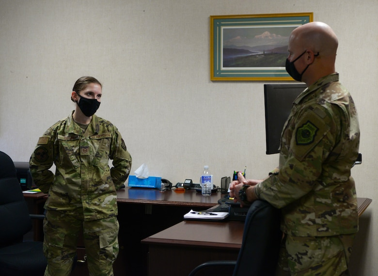 U.S. Air Force Col. David Berkland, right, the 354th Fighter Wing commander, speaks with Tech. Sgt. Rachel Dillon, a 354th Force Support Squadron manpower specialist during a wing leadership immersion on Eielson Air Force Base, Alaska, Oct. 6, 2020. Berkland uses immersions to engage with junior Airmen and frontline supervisors to gain a more in depth look at Eielson's mission. (U.S. Air Force photo by Senior Airman Beaux Hebert)