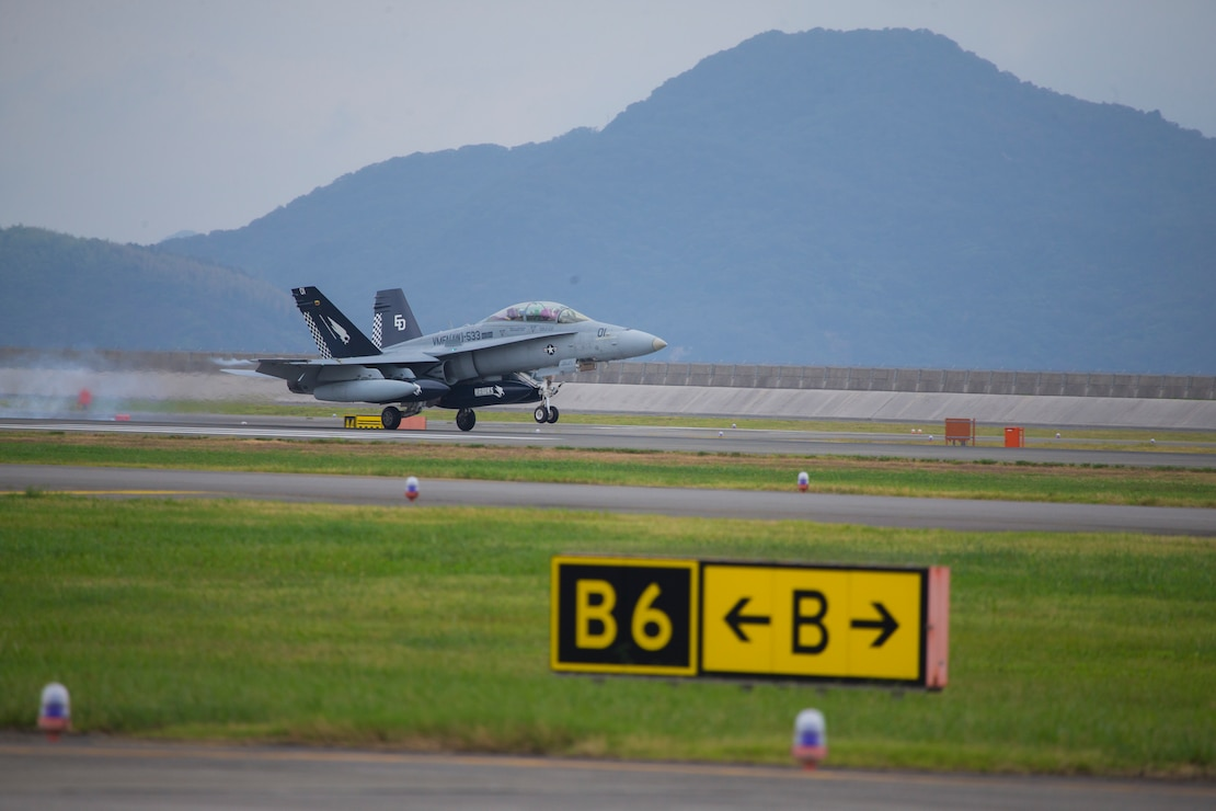 A U.S. Marine Corps F/A-18D Hornet with Marine All Weather Fighter Attack Squadron (VMFA-AW) 533 lands at Marine Corps Air Station Iwakuni, Japan, Sept. 17, 2020. Marines with VMFA(AW) - 533, based out of Marine Corps Air Station Beaufort, South Carolina, take part in a rotational unit deployment program to supplement Marine Aircraft Group 12.