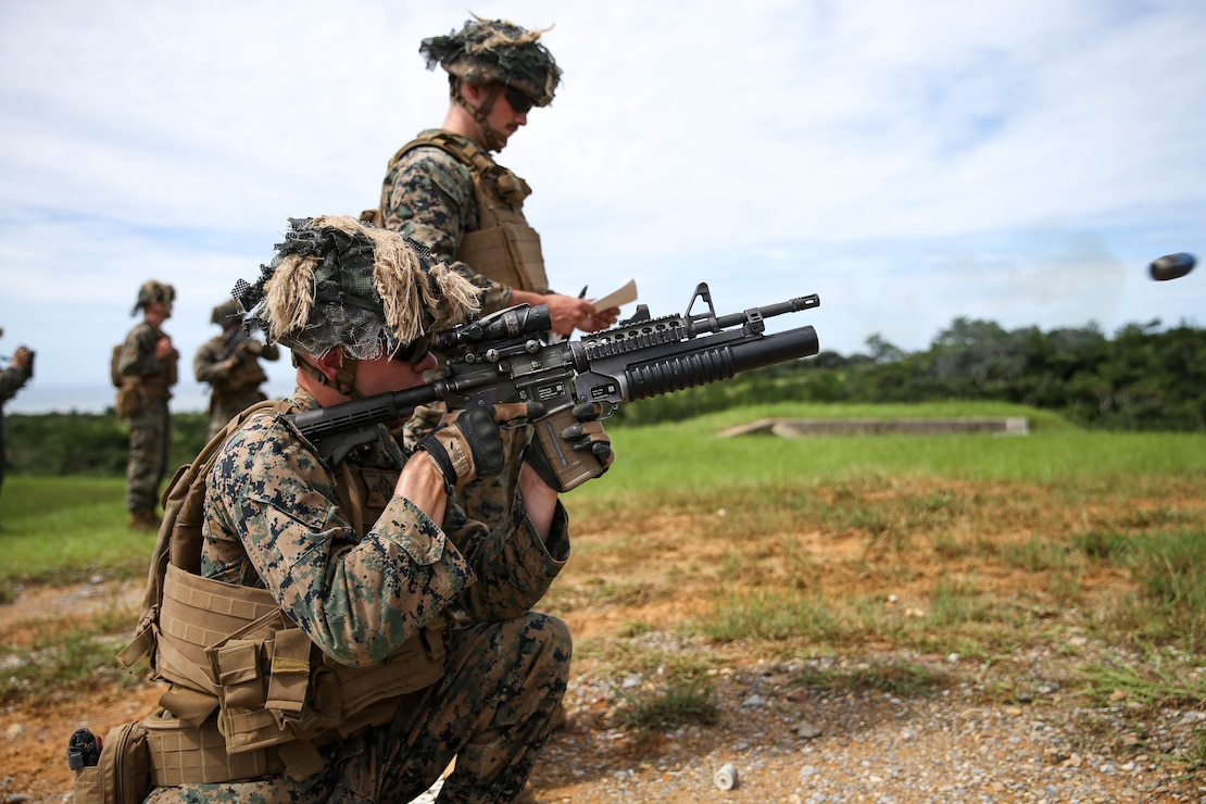 U.S. Marines with Company C, 1st Battalion, 6th Marine Regiment, assigned to 3rd Marine Division under the Unit Deployment Program, fire at targets during a high-explosive weapons range on Camp Schwab, Okinawa, Japan,