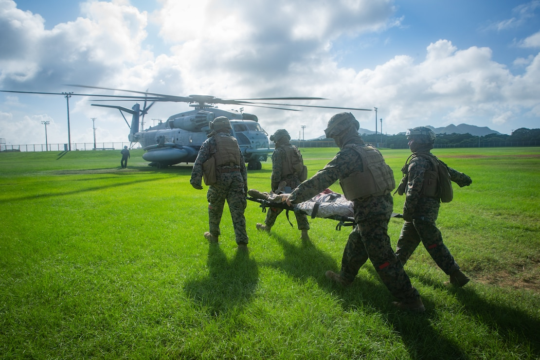 Marines with Combat Logistic Battalion (CLB) 31, 31st Marine Expeditionary Unit (MEU), carry a simulated combat casualty to a CH-53E Super Stallion helicopter with Marine Medium Tiltrotor Squadron 262 (Reinforced), 31st MEU, during a nightingale exercise at Camp Hansen, Okinawa, Japan, July 29, 2020.