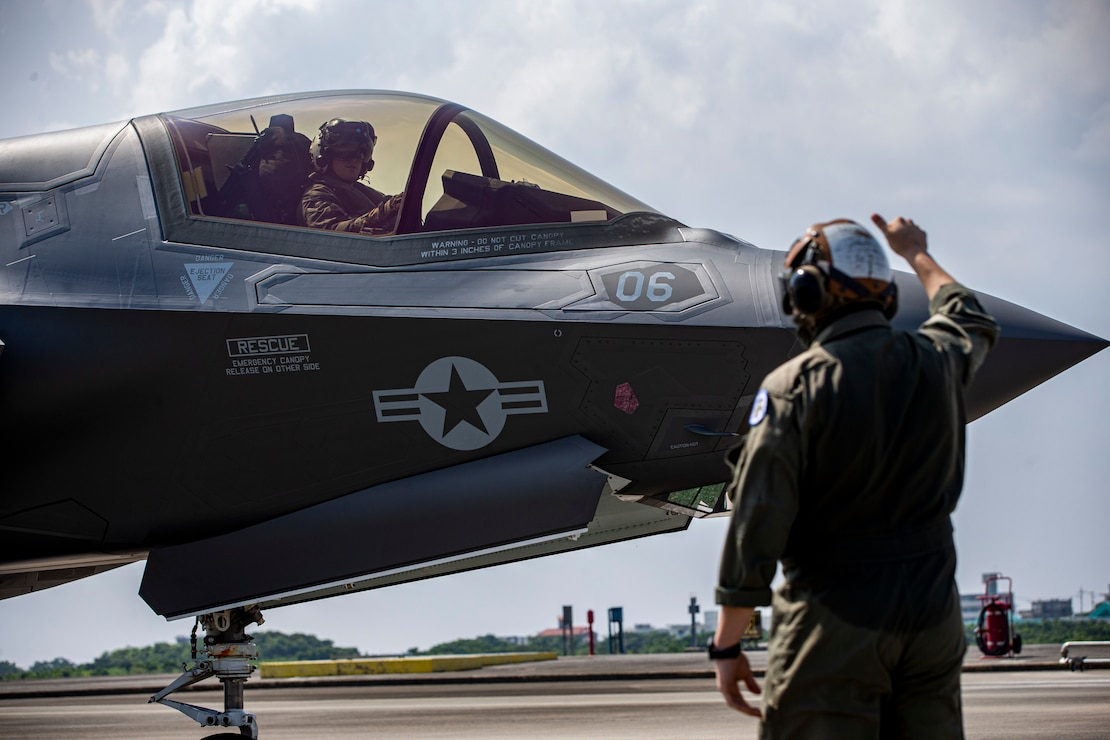 U.S. Marine Corps Lance Cpl. Zachary Reeves, a plane captain, with Marine Fighter Attack Squadron (VMFA) 121, 1st Marine Aircraft Wing, executes refueling operations, Aug. 18, 2020, on Marine Corps Air Station Futenma, Okinawa, Japan.