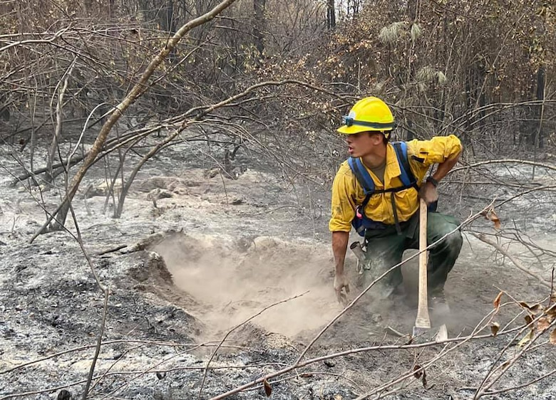 Senior Airman Payton Chiou, 225th Support Squadron, Western Air Defense Sector, helps the Washington State Department of Natural Resources fight wildfires near Inchelium, Washington, Sept. 16, 2020. The 15-person Air National Guard crew spent more than 10 days fighting fires in eastern Washington.