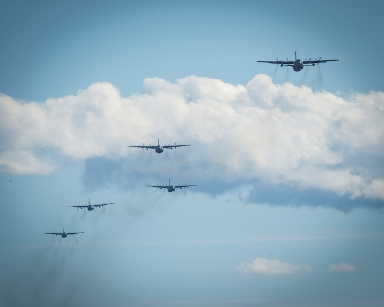 """Five C-130H Hercules aircraft assigned to the 103rd Airlift Wing fly over Westover Air Reserve Base in Chicopee, Massachusetts, Oct. 4, 2020. The """"Max Fly"""" mission challenges the unit to fly the maximum amount of aircraft in its fleet in a single mission in a comprehensive display of the unit's readiness and tactical airlift capabilities."""