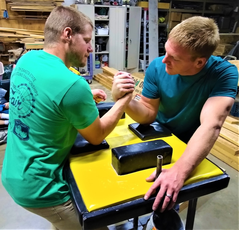 Team Hill employees Lincoln Jarman (left) and 1st Lt. Chad Wanner arm wrestling during a training session Oct. 1 in Logan, Utah. Wanner is a seasoned veteran, with 16 years of experience in competitive arm wrestling, while Jarman has just one year under his belt.