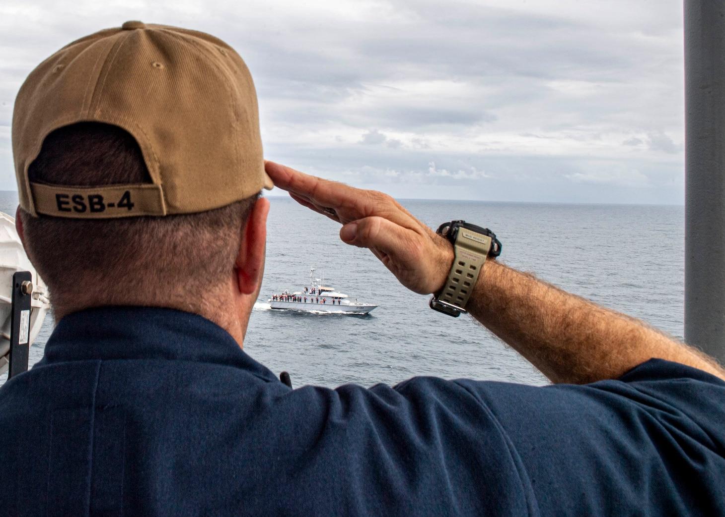 "USS Hershel ""Woody"" Williams and Nigerian navy maneuvering exercise."