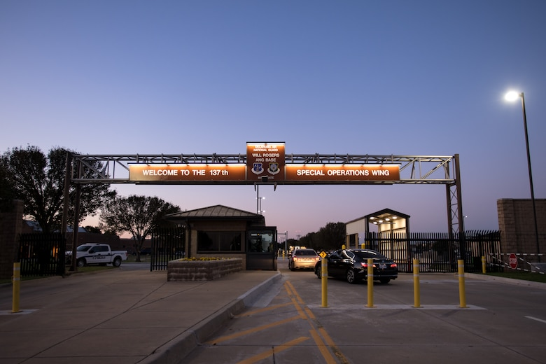 At dawn, Guardsmen enter Will Rogers Air National Guard Base through the updated main gate in Oklahoma City on Oct. 3, 2020. The gate now includes upgraded anti-terrorism force protection measures as well as improved exterior lighting, which was converted to a more energy efficient LED alternative. The new lights use 75% less energy and last 25 times longer than incandescent lighting. Modifications to the main gate were completed on June 19, 2020. (U.S. Air National Guard photo by Senior Airman Alex Kaelke)