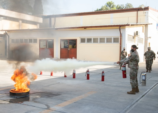 Airmen puts out fire.