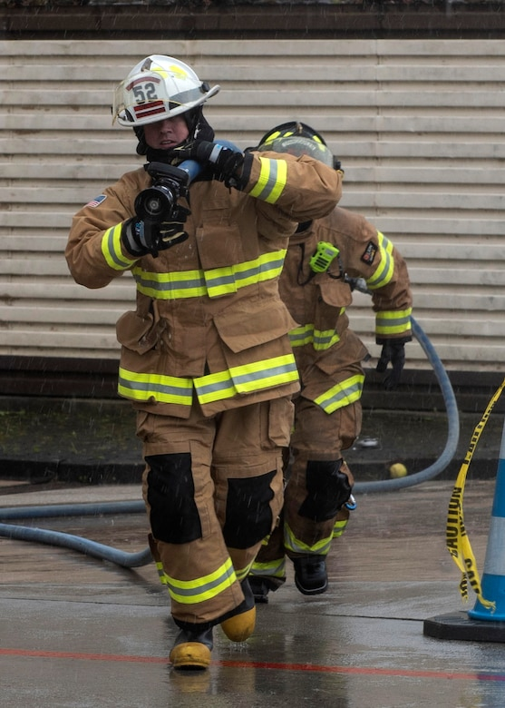 U.S. Air Force Col. David Epperson, 52nd Fighter Wing commander, participates in an obstacle course hosted by the 52nd Civil Engineer Squadron Fire and Emergency Services firefighters, Oct. 5, 2020, at Spangdahlem Air Base, Germany. The obstacle course concluded the Fire Prevention Week activities and consisted of exercises and drills similar to what 52nd FES Airmen go through to maintain mission readiness. (U.S. Air Force photo by Senior Airman Melody W. Howley)