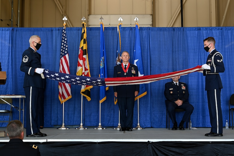 Members from the Maryland National Guard Honor Guard Team fold a flag that was presented to Maj. Gen. Paul C. Maas, Jr., the National Guard assistant to the commander of U.S. Cyber Command, director of the National Security Agency, and Central Security Service chief during his retirement ceremony, Oct. 3, 2020 at the 175th Wing, Maryland Air National Guard, Middle River, Md. Maas retired after 42 years of service in the United States Air Force. (U.S. Air National Guard photo by Tech. Sgt. Enjoli Saunders)