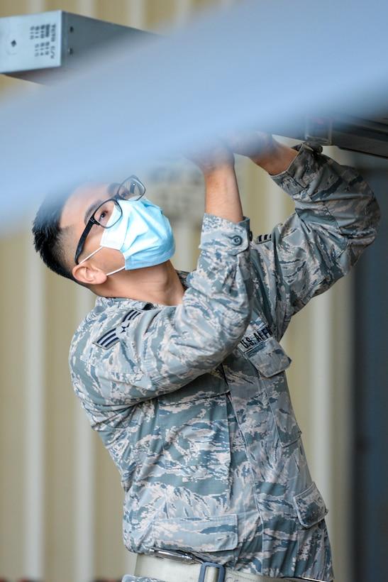 A photo of Senior Airman Herys F. Rivera preparing to load ordinance onto an F-16C Fighting Falcon.