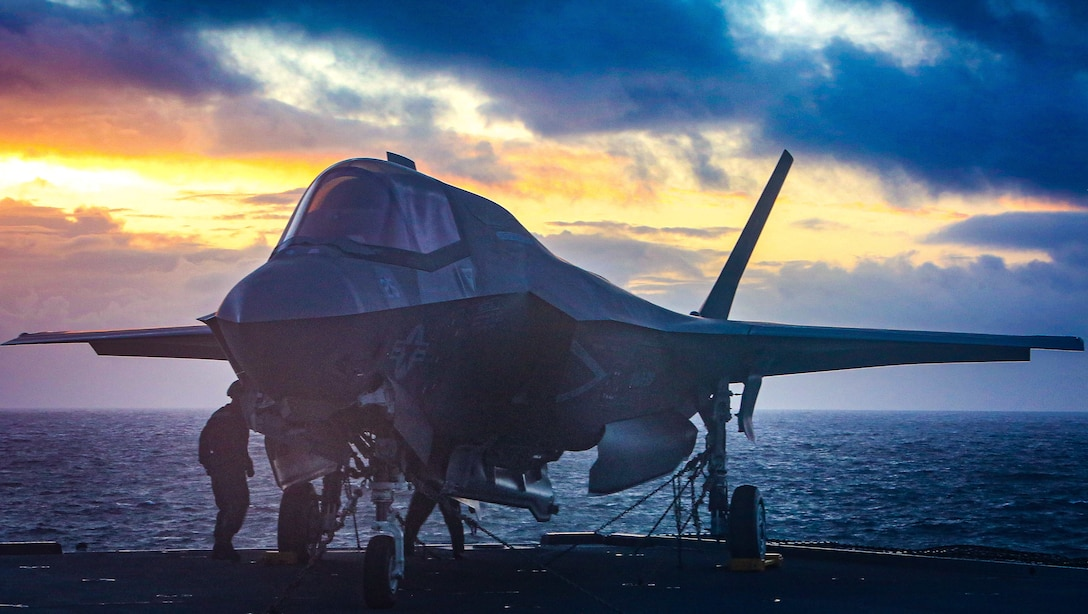 U.S. Marines conduct a safe for flight check on an F-35B Lightning II Joint Strike Fighter aboard HMS Queen Elizabeth at sea, Oct. 6.
