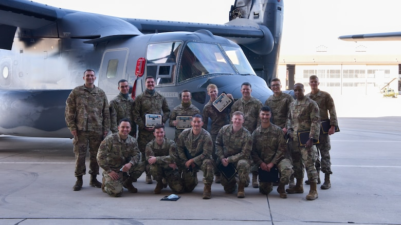 Service members pose for a group photo