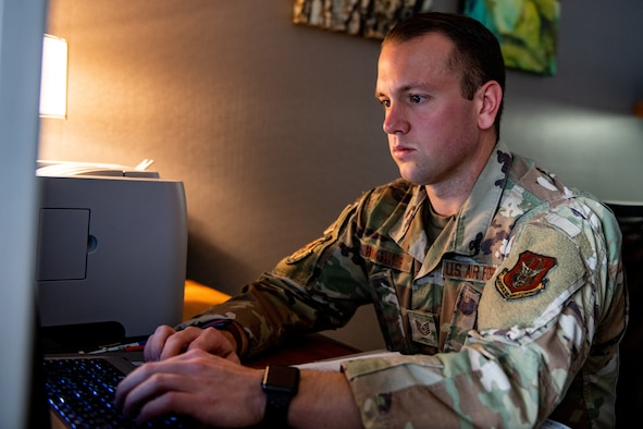 Tech. Sgt. Chris Hughes, an aviation resource manager assigned to the 910th Airlift Wing's squadron aviation resource management office, works on creating flight authorizations, Sept. 22, 2020, Boise, Idaho.