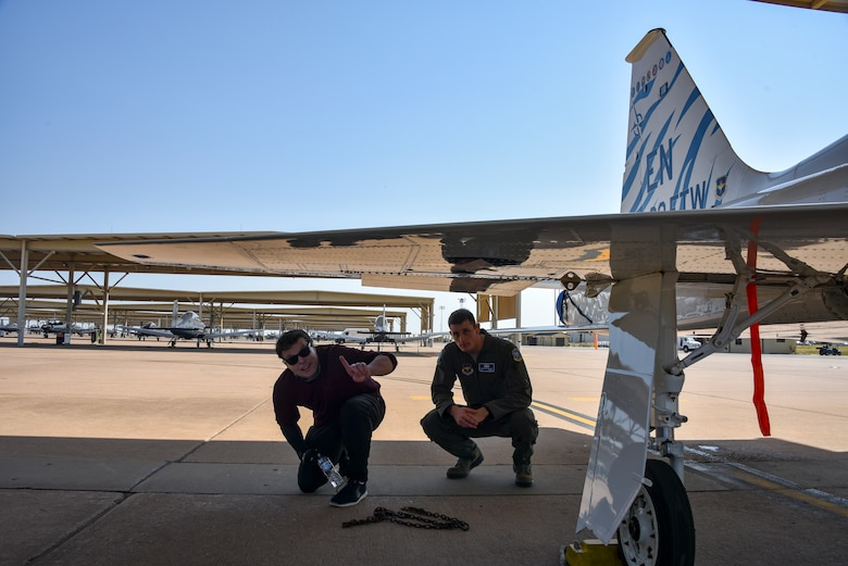 Jared Estes takes a look at a T-38C Talon with 2nd Lt. Michael Brown