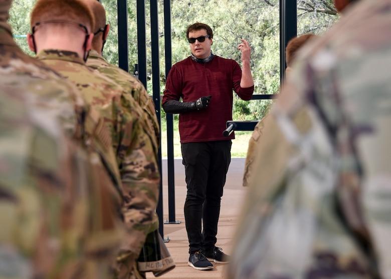 Jared Estes speaks to 366th Training Squadron explosive ordinance disposal Airmen