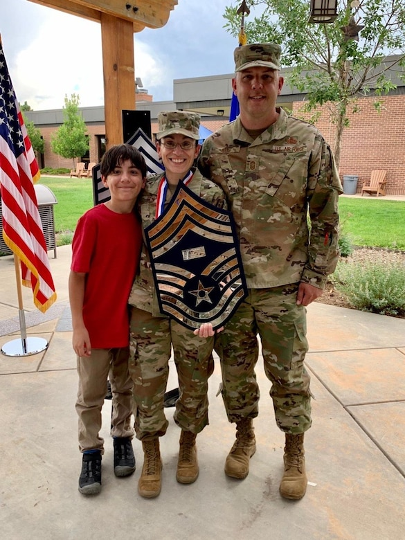 From left, Brandon Stys, 11, chief master sergeant promotee, Senior Master Sgt. Taryn Stys, 4th Space Control Squadron superintendent, and Chief Master Sgt. Zack Stys, Headquarters United States Space Force enlisted cyber functional manager, smile for a photo during the chief master sergeant recognition ceremony at Peterson Air Force Base, Colorado, July 22, 2020. Stys sewed on the rank of chief master sergeant Oct. 1, 2020, almost one month after transitioning to the USSF. (courtesy photo)