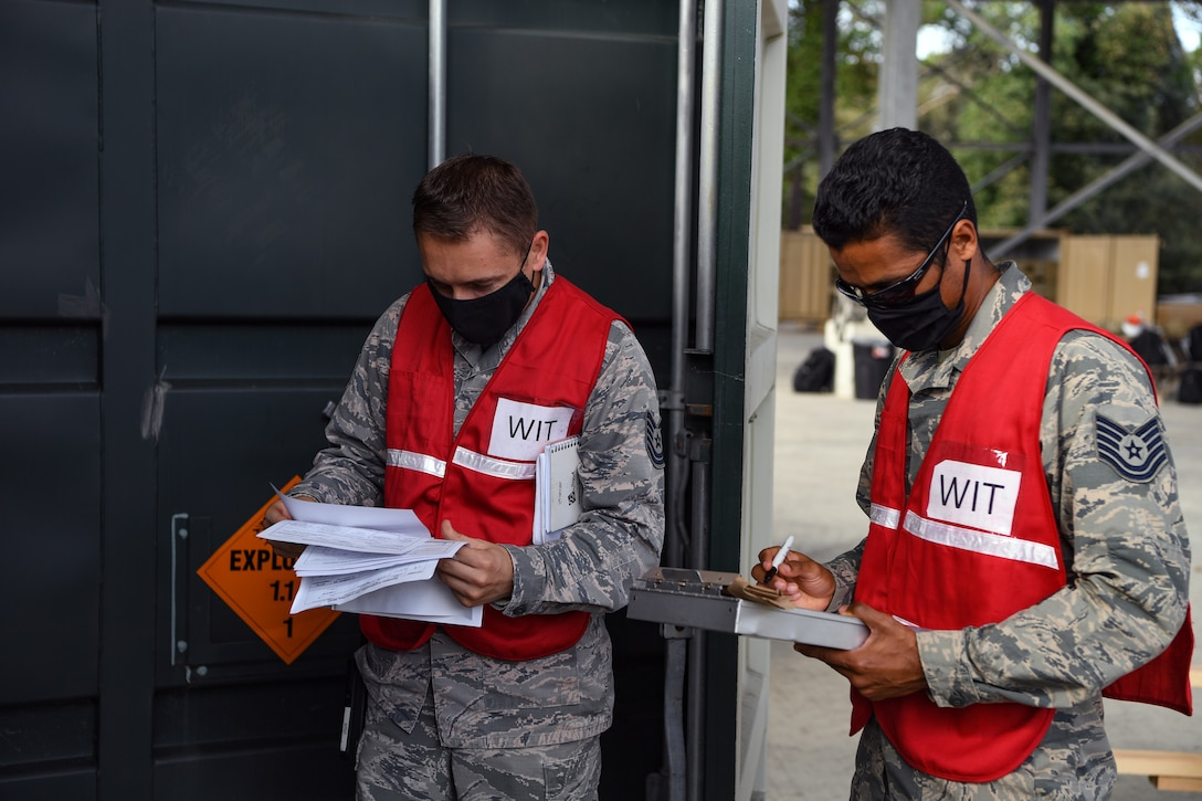Airmen with the 31st Fighter Wing perform an inspection on an intermodal shipping container during Waking Giant at Camp Darby, Italy, Oct. 7, 2020. Quality Assurance and the Wing Inspection Team ensured all safety guidance and rules were being followed. (U.S. Air Force photo by Airman 1st Class Thomas S. Keisler IV)