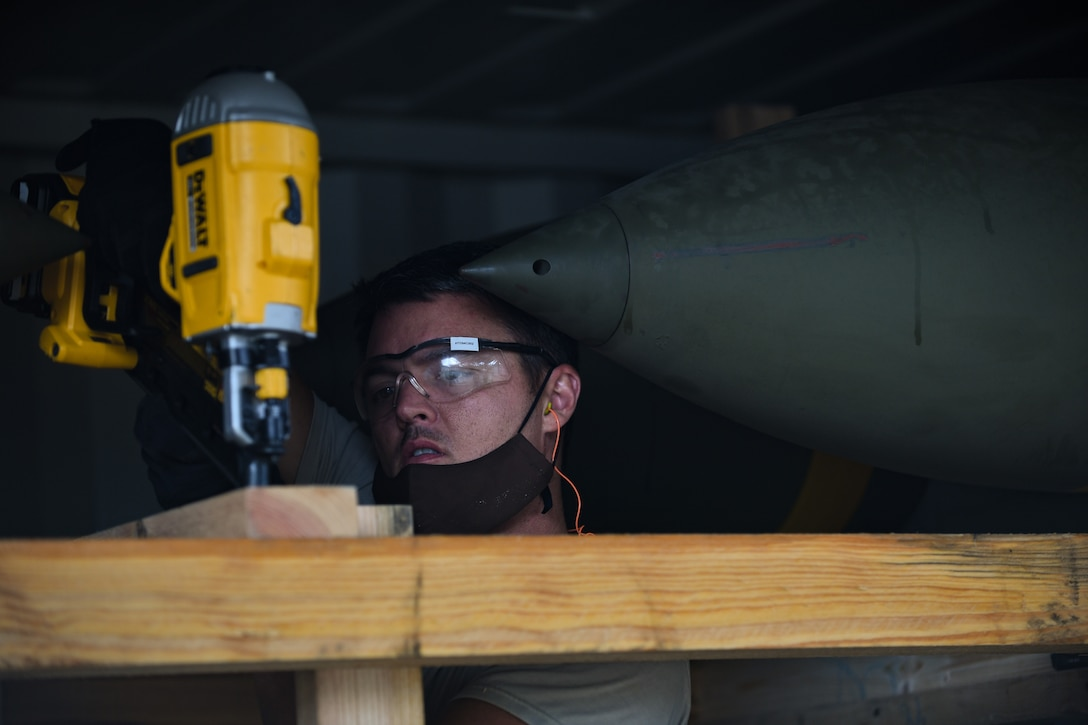 An Airman with the 731st Munitions Squadron secures a bracing inside an intermodal shipping container during Waking Giant at Camp Darby, Italy, Oct. 7, 2020. The 731st MUNS endeavors to be U.S. Air Forces in Europe's premier munitions hub, capable of receiving, maintaining and shipping munitions by rail, sea, or road to any destination globally. (U.S. Air Force photo by Airman 1st Class Thomas S. Keisler IV)
