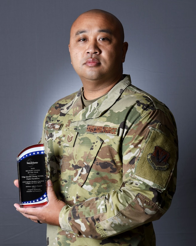 Photo of Airman holding award