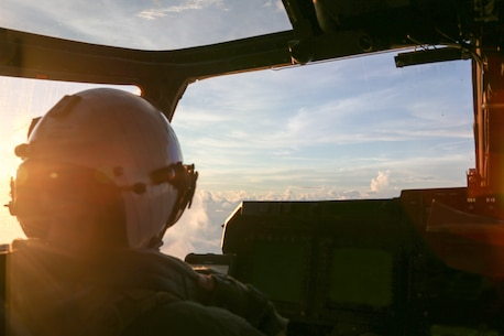 PHILIPPINE SEA (Sept. 27, 2020) U.S. Marine Capt. William Cooper, a pilot with Marine Medium Tiltrotor Squadron (VMM) 262 (Reinforced), 31st Marine Expeditionary Unit (MEU) and native of Los Alamos, New Mexico, goes over a checklist before dropping illumination flares from an MV-22B Osprey after taking from amphibious assault ship USS America (LHA 6).