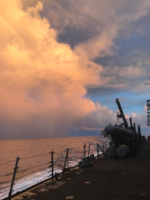 A sunset is visible from USS Barry (DDG 52).