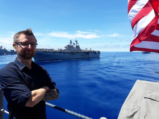Brian Mills, a naval architect from Naval Surface Warfare Center, Carderock Division, stands aboard USS Antietam.