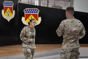 Chief Master Sgt. Cynthia Villa, 4th Air Force command chief, answers questions from the audience at a socially distanced enlisted call with Reserve Citizen Airmen of the 445th Airlift Wing, Sept. 12, 2020 at Wright-Patterson Air Force Base, Ohio.