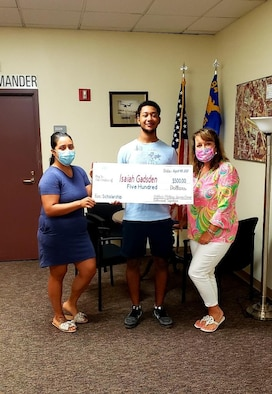 The Dobbins Military Spouse Group presents a check to Specialist Isaiah Gadsden, an Army National Guard infantryman with B Co 1/121, at Dobbins Air Reserve Base, Ga. Aug. 4, 2020. Gadsden was awarded $500 for the Dobbins Military Spouse Group Dependent Scholarship. (Courtesy photo)