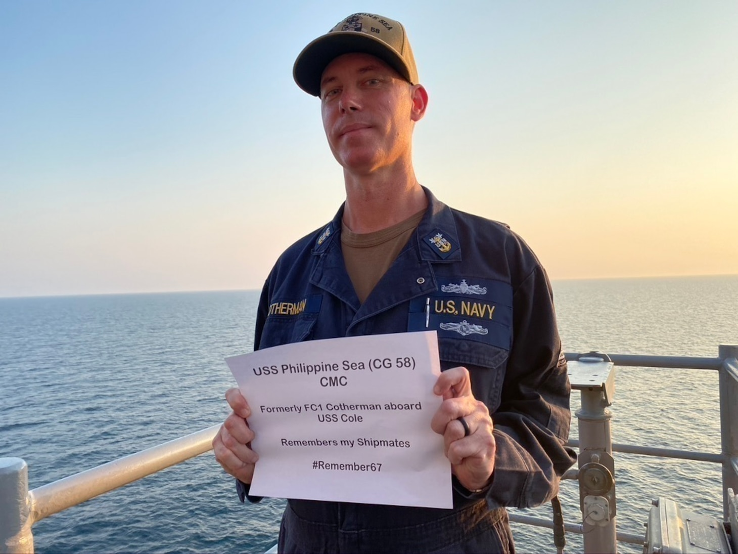 Acting Command Master Chief Aegis Fire Controlman Craig Cotherman, assigned to the guided-missile cruiser USS Philippine Sea (CG 58), honors his shipmates killed when the USS Cole was attacked on Oct. 12, 2000.