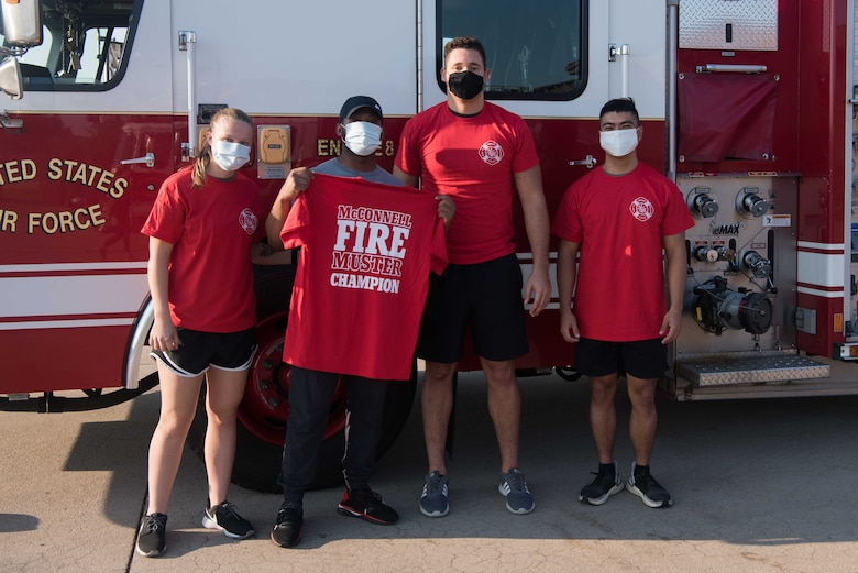 From left to right, Senior Airman Megan Galasso, Senior Airman Tyler Cogdelo, Senior Airman Nicholas Summit, 22nd Maintenance Squadron aerospace ground equipment journeymen, and Airman 1st Class Chris Padilla, 22nd MXS AGE apprentice, pose for a photo Oct. 8, 2020, at McConnell Air Force Base, Kansas. The team won McConnell's 2020 Fire Muster with the fastest time of the day with 2 minutes and 52 seconds. (U.S. Air Force photo by Senior Airman Alexi Bosarge)