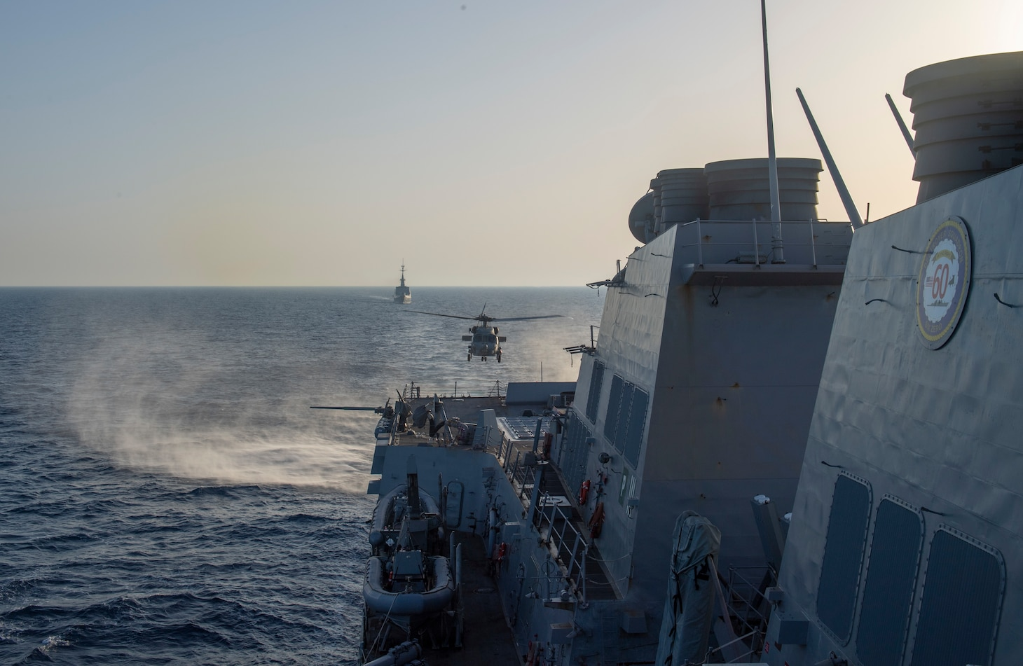 The French Navy executes a passing exercise with the Arleigh Burke-class guided-missile destroyer USS Roosevelt (DDG 80)