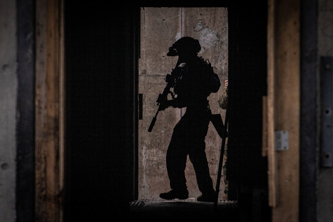 A U.S. Marine searches a room during a house clearing exercise on Camp Hansen, Okinawa, Japan, Oct. 7.