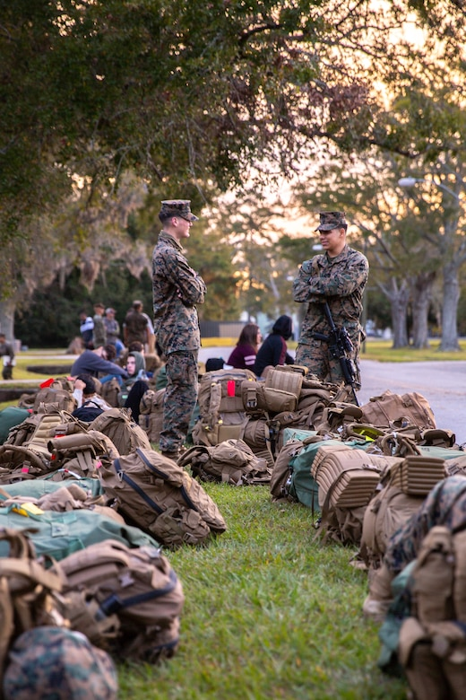 U.S. Marines with II Marine Expeditionary Force on Camp Lejeune, N.C., prepare for departure to Marine Expeditionary Force Exercise 21.1 taking place on Fort A.P. Hill, Va., Oct. 9, 2020. MEFEX 21.1 is a MEF level exercise consisting of approximately 1,200 Marines and sailors across the eastern United States. The exercise is structured to simulate a deployed environment, reinforce command and control, and maintain the warfighting ability of II MEF to train, fight, and win in every clime and place. (U.S. Marine Corps photo by Sgt. Austyn Saylor)