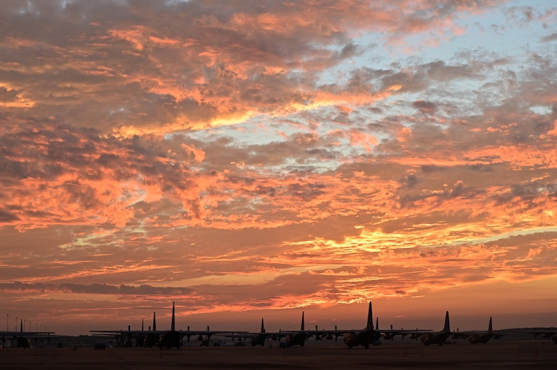 Planes sit on flight line at sunset