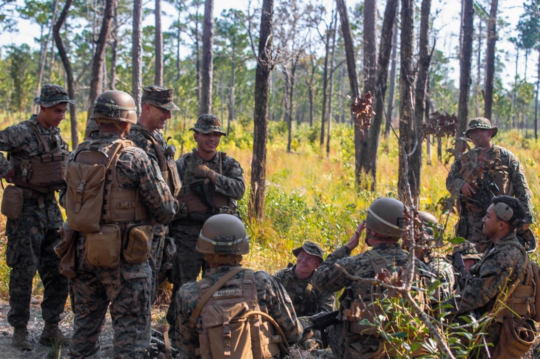U.S. Marine Corps Maj. Gen. Francis L. Donovan, commanding general of 2nd Marine Division, speaks with Marines of 2nd Battalion, 8th Marine Regiment (V28), 2nd Marine Division at a range on Camp Lejeune, North Carolina, Oct. 8, 2020. V28 rehearsed combat maneuvers to enhance proficiency and combat readiness. Donovan supervised part of the training, exchanging stories of experiences with Marines of all grades. (U.S. Marine Corps photo by Lance Cpl. Jacqueline Parsons)