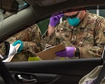 Tennessee National Guard Soldiers assigned to Task Force Medical conduct COVID-19 testing at the drive-thru testing site in Coffee County on April 19, 2020. The Guard has worked with state and local agencies to test more than 400,000 Tennesseans.
