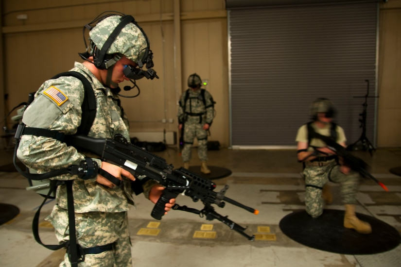 Three service members are outfitted with virtual reality technology.