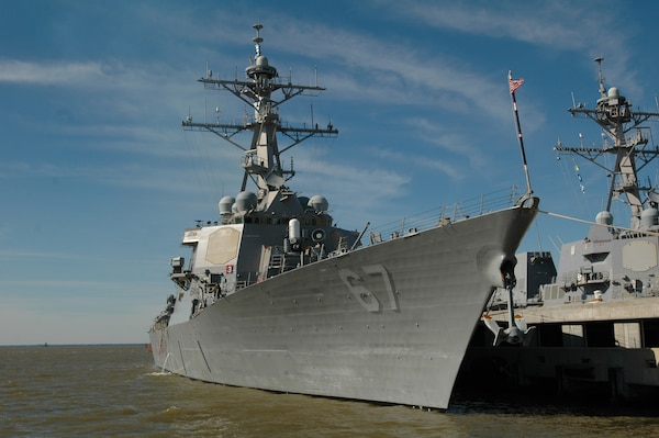 The Arleigh Burke-class guided-missile destroyer USS Cole is pierside at Naval Station Norfolk before departing on a scheduled seven-month deployment. Cole will operate in the Mediterranean Sea and the Persian Gulf during her deployment conducting maritime security operations. (Photo by: Seaman Scott Pittman)