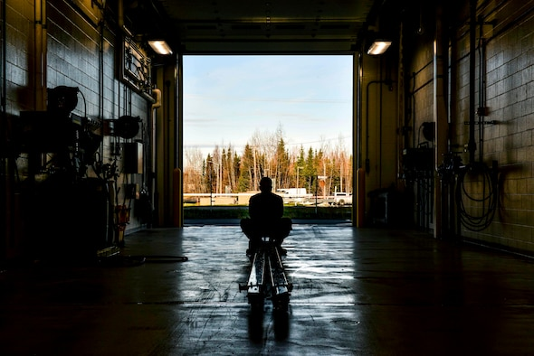 U.S. Air Force Airman 1st Class Matthew Washington, a 354th Maintenance Squadron (MXS) Aerospace Ground Equipment craftsman, lifts a tow bar at Eielson Air Force Base, Alaska, Oct. 8, 2020.