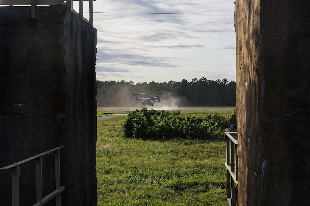 An MV-22B Osprey executes an approach during an airfield assault and seizure simulation at Marine Corps Outlying Landing Field, Camp Davis, NC, June 9, 2020. The simulation was a part of a Marine Corps Air-Ground Task Force exercise with the 24th Marine Expeditionary Unit. The exercise is designed to increase the MEU's proficiency and enhance their capabilities as a MAGTF. The aircraft is with Marine Medium Tilt-Rotor Squadron 162. (U.S. Marine Corps photo by Cpl. Margaret Gale)