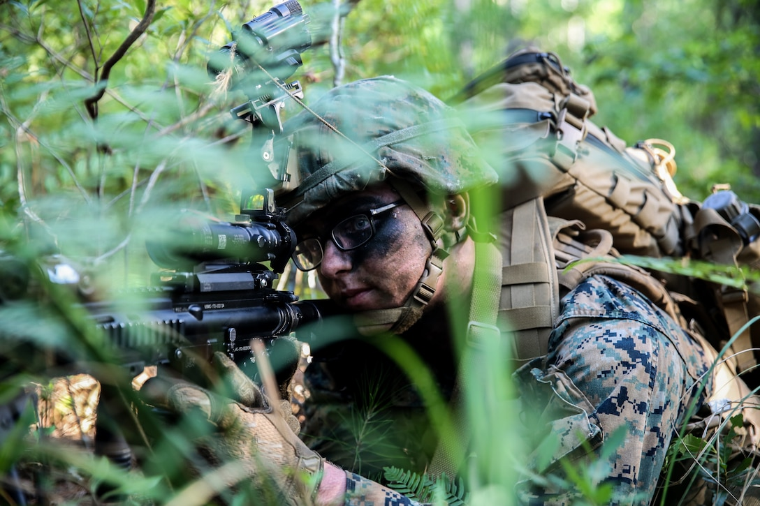Private First Class Christopher Mianton posts security during an airfield assault and seizure simulation at Marine Corps Outlying Landing Field, Camp Davis, NC, June 9, 2020. The simulation was a part of a Marine Corps Air-Ground Task Force exercise with the 24th Marine Expeditionary Unit. The exercise is designed to increase the MEU's proficiency and enhance their capabilities as a MAGTF. Mianton is an infantry automatic rifle gunner with 1st Battalion, 8th Marine Regiment. (U.S. Marine Corps photo by Cpl. Margaret Gale)