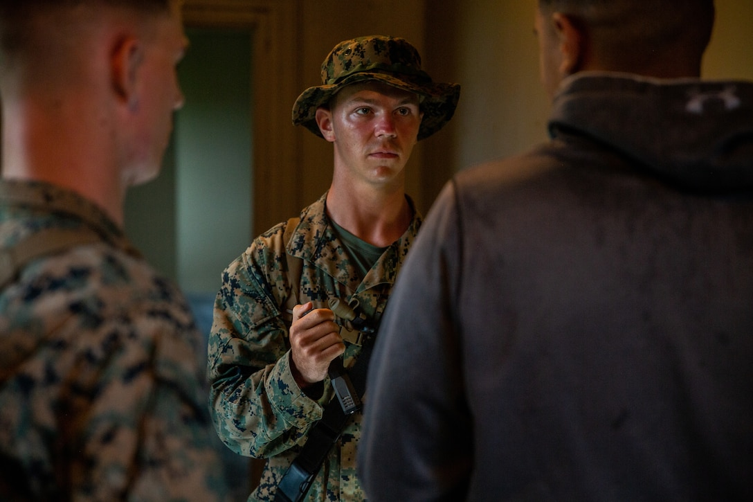 Lance Cpl. Trentton Taylor conducts a hasty search during a simulated Non-combatant Evacuation Operation at Marine Corps Outlying Landing Field, Camp Davis, NC, June 12, 2020. The simulation was a part of a Marine Corps Air-Ground Task Force exercise with the 24th Marine Expeditionary Unit. This exercise is designed to increase the MEU's proficiency and interoperability as a MAGTF. Taylor is a landing support specialist with Combat Logistics Battalion 24. (U.S. Marine Corps photo by Cpl. Margaret Gale)