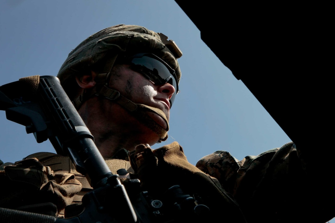 U.S. Marine Corps Lance Cpl. Joseph Ricci, a mortarman with 1st Battalion 8th Marines, keeps watch while being transported in an amphibious assault vehicle at Camp Lejeune, N.C., Sept. 22, 2020. The purpose of the exercise was to promote familiarization with ship to shore procedures and raid tactics for pre-deployment readiness with the 24th Marine Expeditionary Unit. (U.S. Marine Corps photo by Lance Cpl. Davis Harris)
