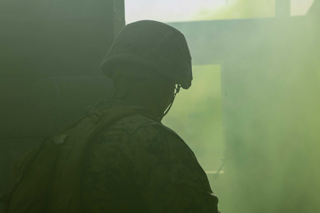 U.S. Marine Corps Lance Cpl. Rhaffy Perezazury, a mortarman with 1st Battalion 8th Marines, clears a room during a raid training exercise at Camp Lejeune, N.C., Sept. 22, 2020. The purpose of the exercise was to promote familiarization with ship to shore procedures and raid tactics for pre-deployment readiness with the 24th Marine Expeditionary Unit. (U.S. Marine Corps photo by Lance Cpl. Davis Harris)
