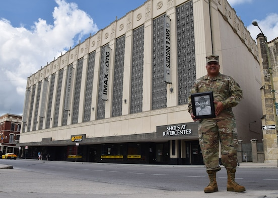 Chief Master Sgt. Joe G. Gonzalez Jr., 433rd Mission Support Group, group superintendent, holds a picture of his father, Joe G. Gonzalez Sr., in front of the Joske's Department Store building, Oct. 9, 2020 in San Antonio. Gonzalez stated that his father, a welder, worked on the steel décor between the building's columns. The building is part of the National Register of Historic Places-listed and City of San Antonio Alamo Plaza Historic District and is a City of San Antonio local landmark (U.S. Air Force photo by Tech. Sgt. Iram Carmona)