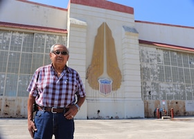 Felix R. Gonzalez, grandfather of Tech. Sgt. Christine R. Narro, 433rd Aerospace Medicine Squadron, optometry technician, visits an old hanger Oct. 10, 2020 on what is now called Kelly Field that once was used for aircraft in depot status at Kelly Air Force Base. Gonzalez recalls his work on the Veterans Monument on Kelly Air Force Base, that was dedicated in May of 1992 to honor service members who served in Operations Desert Shield and Desert Storm. The Monument has since been moved from its original location until a new location is found. (U.S. Air Force photo by Tech. Sgt. Iram Carmona)