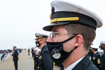 Sailors assigned to the Arleigh Burke-class guided missile destroyer USS Cole (DDG 67) stand at attention during the 20th Anniversary memorial ceremony onboard Naval Station Norfolk.