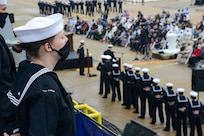 NORFOLK (Oct. 12, 2020) Sailors aboard the Arleigh Burke-class guided missile destroyer USS Cole (DDG 67) stand at parade rest during the 20th Anniversary memorial ceremony onboard Naval Station Norfolk. USS Cole was attacked by terrorists at 11:18 a.m. on Oct. 12, 2000, while moored for refueling in the Port of Aden, Yemen. The explosive bomb created a 40-by-60-foot hole on the port side of the ship, and the Cole's Sailors fought fires and flooding for the following 96 hours to keep the ship afloat. Commemoration events on the 20th anniversary of the attack remember and honor the 17 Sailors who were killed, the 37 who were injured and the Gold Star families. (U.S. Navy photo by Mass Communication Specialist Jacob Milham)