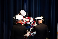 Vice Adm. James Kilby, deputy chief of naval operations, warfighting requirements and capabilities, and Rear Adm. Carl Lahti, commandant of Naval District Washington, place a wreath at the Navy Memorial Burke Theater commemorating the 20th anniversary of the attack on the U.S. Navy guided-missile destroyer USS Cole (DDG 67), Oct. 12.