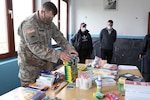 Maj. Chad Plaisted, with the Oregon Army National Guard 41st Infantry Brigade Combat Team, delivers donated supplies to an underserved primary school Oct. 6, 2020, in Bivolak/Bivoljak, Kosovo. Plaisted and other 41st IBCT Soldiers have been deployed in Kosovo since the beginning of 2020 as members of the U.S.-led brigade level KFOR Regional-Command East.